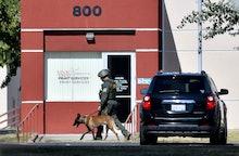 SAN JACINTO, CA - NOVEMBER 06: A Riverside County sheriff deputy searches Mt. San Jacinto College in...