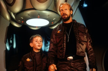 William Hurt standing next to a child in a scene from the film 'Lost In Space', 1998. (Photo by New ...