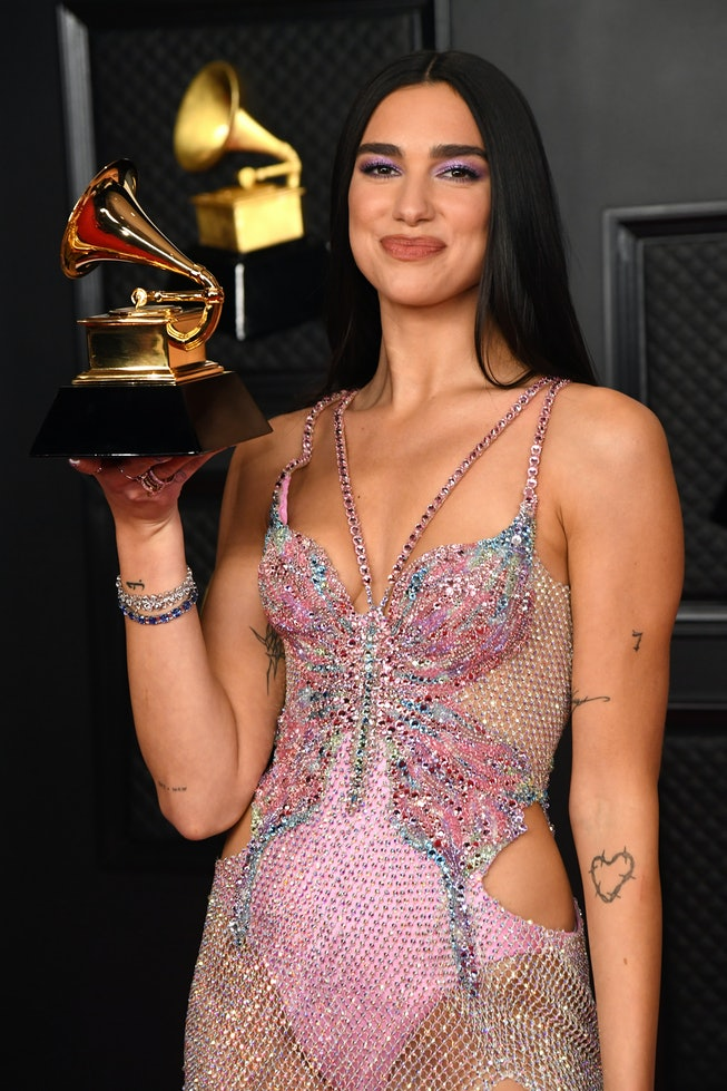 LOS ANGELES, CALIFORNIA - MARCH 14: Dua Lipa, winner of Best Pop Vocal Album for 'Future Nostalgia',...