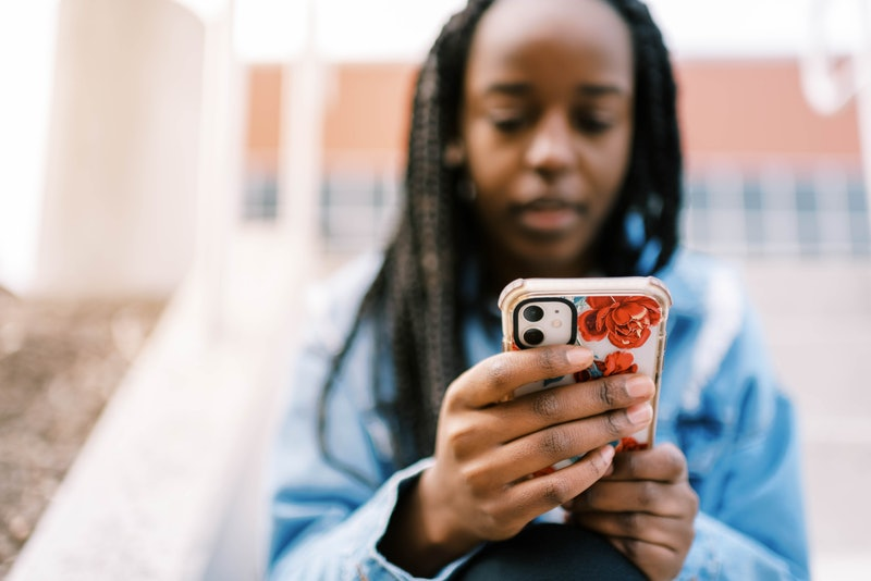A woman stares at her phone as a number similar to hers calls her. Here's the deal if you keep getti...