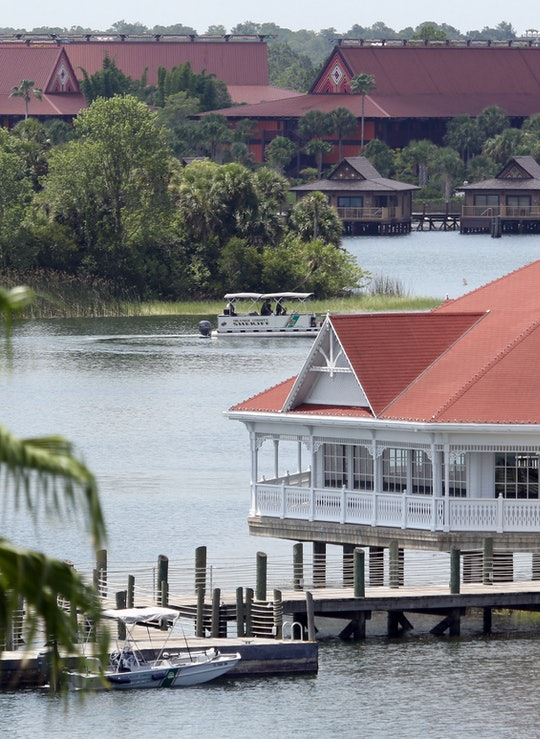 A boat belonging to the Orange County Sheriff's office searches the Seven Seas lagoon between Disney...