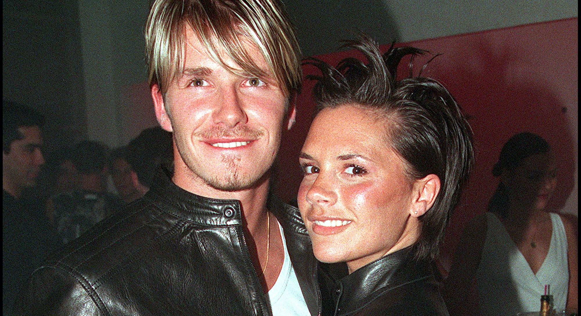 LONDON - JUNE 11: British footballer David Beckham and wife Victoria Beckham attend the Versace Stor...