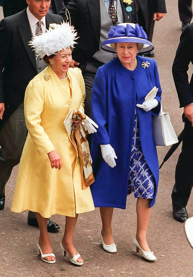 Queen Elizabeth makes Princess Margaret laugh.