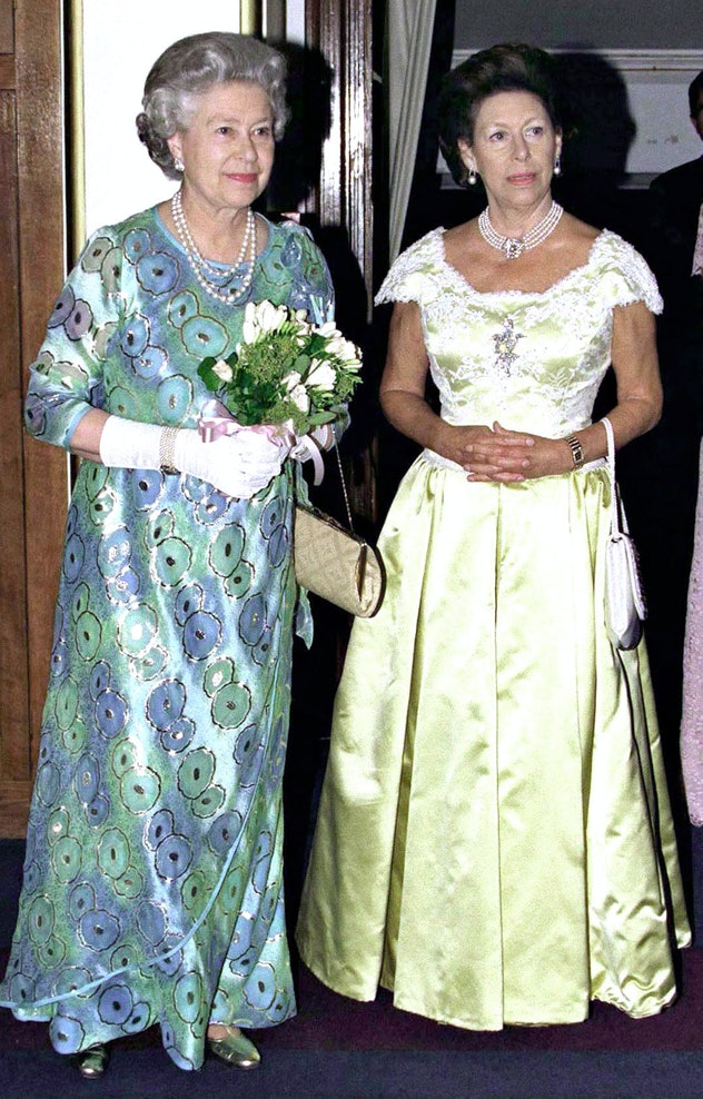 Queen Elizabeth and Princess Margaret dress for a night on the town.