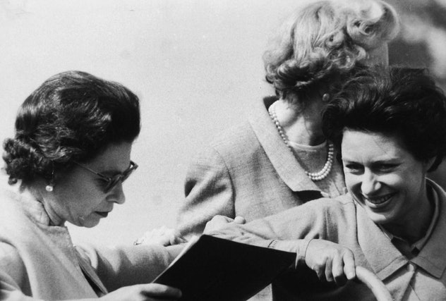Princess Margaret laughing with her sister at the horse trials.