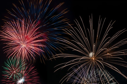 A very large and colorful firework explodes in the night sky in a celebration of freedom on the Four...