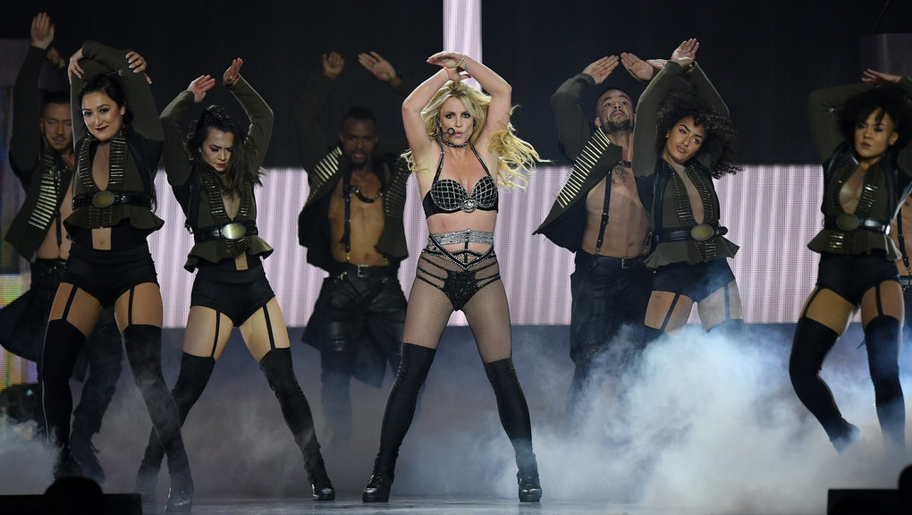 """LONDON, ENGLAND - AUGUST 24:  Britney Spears on stage during the """"Piece Of Me"""" Summer Tour at the O2..."""