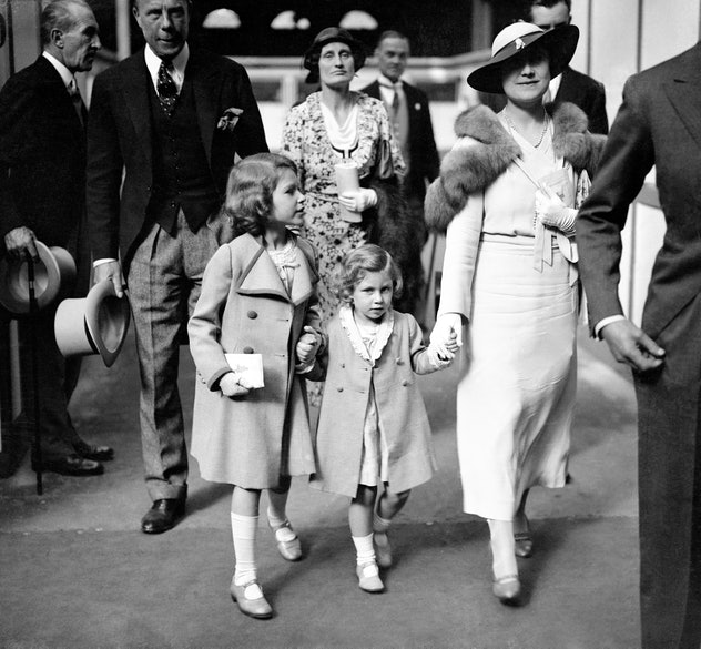 Princesses Elizabeth and Margaret with their mother.