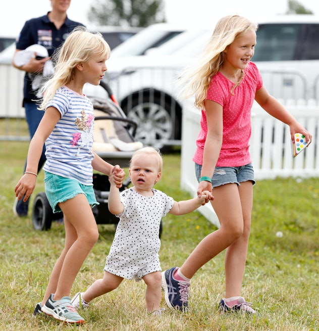 Lena Tindall is helped by cousins Isla and Savannah.
