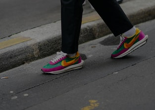PARIS, FRANCE - JANUARY 15: A guest wears black pants, white socks, multicolor Nike sneakers, outside Berluti, during Paris Fashion Week - Menswear F/W 2020-2021 on January 17, 2020 in Paris, France. (Photo by Edward Berthelot/Getty Images)