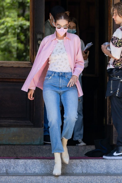 Gigi Hadid wears tank top and jeans from the recent H&M x Brock Collection collab while grabbing ice...