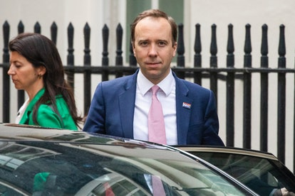 LONDON, ENGLAND  - MAY 01: Health Secretary Matt Hancock leaves 10 Downing Street with aide Gina Coladangelo after the daily press briefing on May 01, 2020 in London, England. Mr Hancock announced that the government's pledge to conduct 100,000 Covid-19 tests per day had been successful. British Prime Minister Boris Johnson, who returned to Downing Street this week after recovering from Covid-19, said the country needed to continue its lockdown measures to avoid a second spike in infections. (Photo by Dan Kitwood/Getty Images)