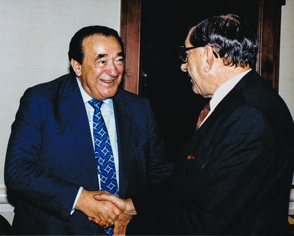 Ghislaine Maxwell's father Robert Maxwell shakes hands with the South African Ambassador to the Unit...