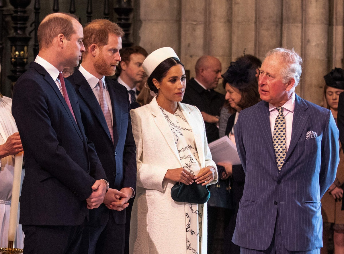 Britain's Meghan, Duchess of Sussex (2R) talks with Britain's Prince Charles, Prince of Wales (R) as...