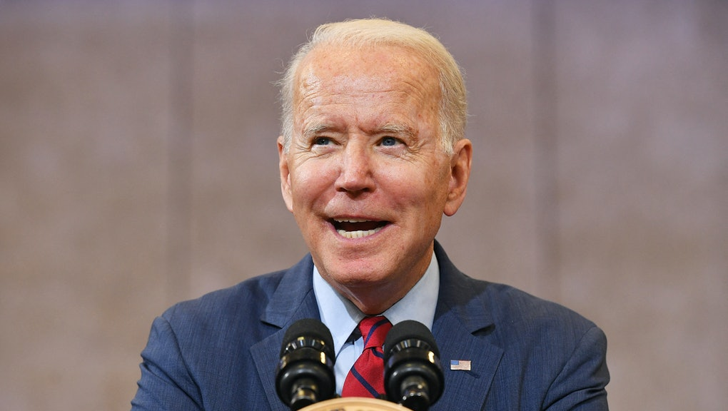 US President Joe Biden speaks after visiting a mobile vaccination unit at the Green Road Community C...