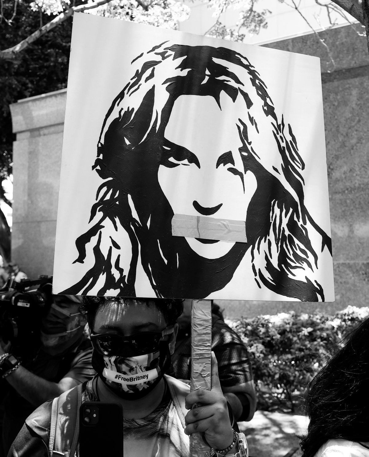 #FreeBritney activists protest at Los Angeles Grand Park during a conservatorship hearing for Britne...