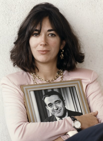 Ghislaine Maxwell holding a framed photograph of her father Robert Maxwell.