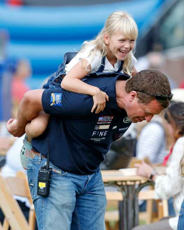 Isla Phillips gets a piggyback ride from her dad Peter Phillips.