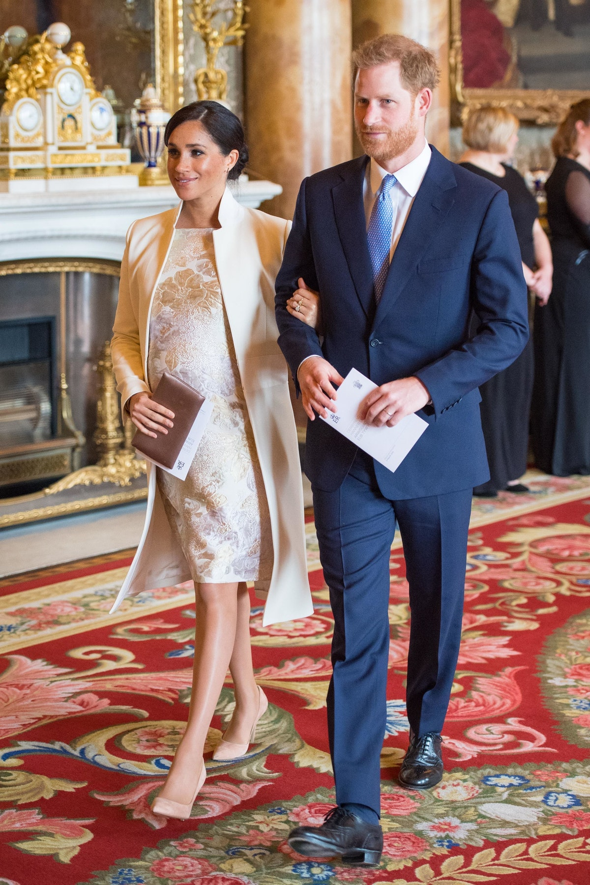 Britain's Prince Harry, Duke of Sussex, (R) and Britain's Meghan, Duchess of Sussex (L) attend a rec...