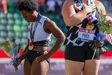 EUGENE, OREGON - JUNE 26: Gwendolyn Berry (L), third place, turns away from U.S. flag during the U.S...