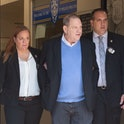 TOPSHOT - Harvey Weinstein (C) leaves the New York City Police Department's First Precinct on May 25...