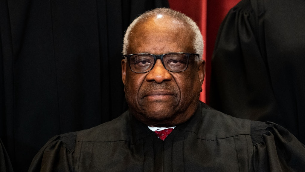 Associate Justice Clarence Thomas sits during a group photo of the Justices at the Supreme Court in ...