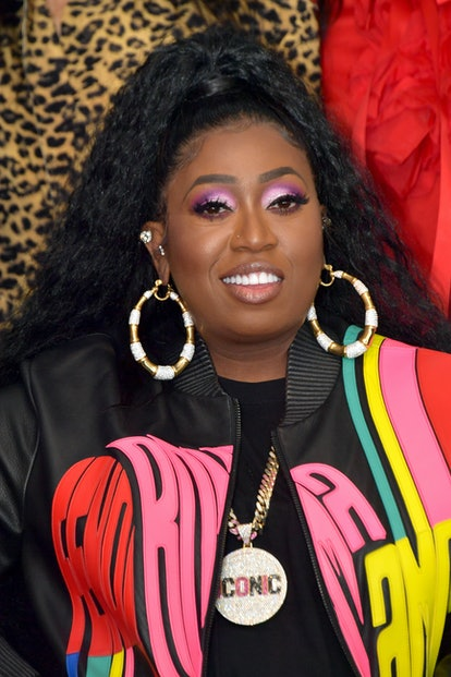 The talented and entertaining celebrity Cancer Missy Elliott attends an event while wearing a bright colorful jacket.