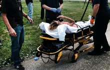 WARREN, OH - JULY 14: Medical workers and police treat a woman who has overdosed on heroin, the seco...