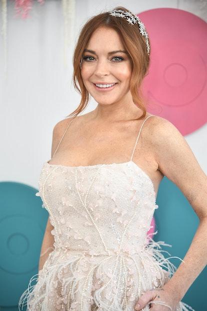 Celebrity Cancer Lindsay Lohan walks the red carpet in dazzling dress.