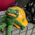 """HONG KONG, CHINA - November 23: A stuffed doll of Pepe the Frog sits at the main entrance of the campus at The Hong Kong Poytechnic University on November 23, 2019 in Hong Kong, China. Anti-government protesters armed with bricks, firebombs, and bows and arrows fought with the police at university campuses last week as demonstrations in Hong Kong stretched into its sixth month with demands for an independent inquiry into police brutality, the retraction of the word """"riot"""" to describe the rallies, and genuine universal suffrage. (Photo by Anthony Kwan/Getty Images)"""