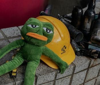 HONG KONG, CHINA - November 23: A stuffed doll of Pepe the Frog sits at the main entrance of the cam...