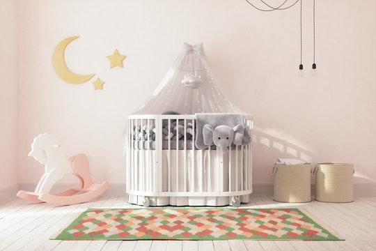 Empty crib in a decorated nursery at home.