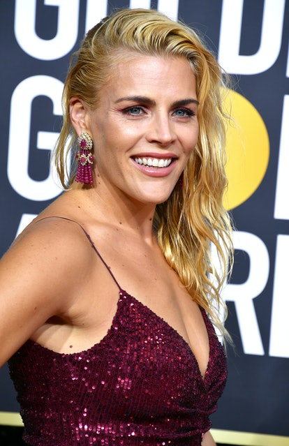 Busy Philipps flashes a bright small showing off her celebrity Cancer quality on the red carpet.