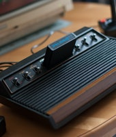 [UNVERIFIED CONTENT] Atari 2600 VCS console, full view, with joysticks and Commodore 1084S monitor p...