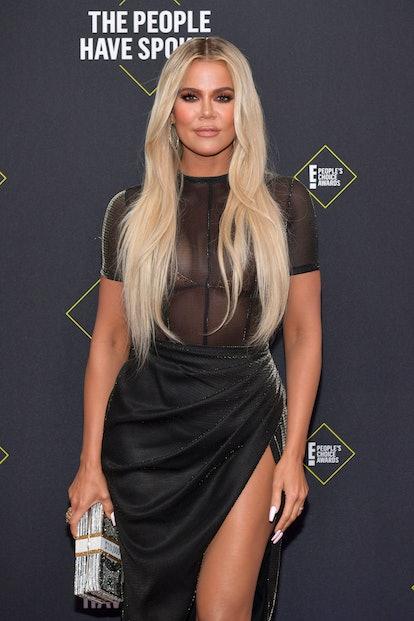 Celebrity Cancer Khloé Kardashian walks the red carpet during an entertainment event.