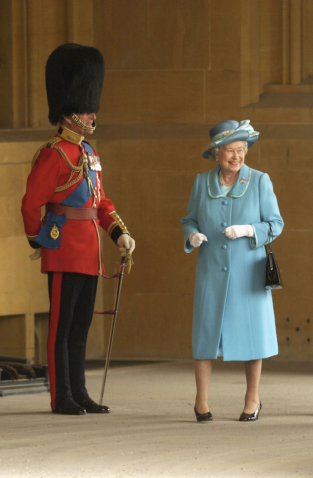 Queen Elizabeth II and Prince Philip enjoy the spectacle, as a swarm of bees cause concern prior to ...