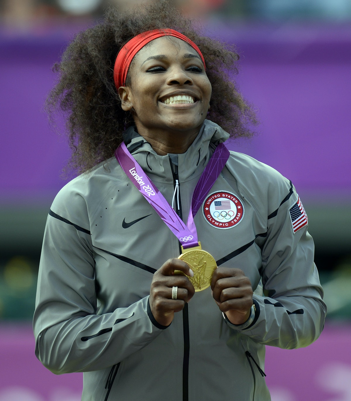 Serena William, shown here donning an Olympic gold medal, is driven to win.