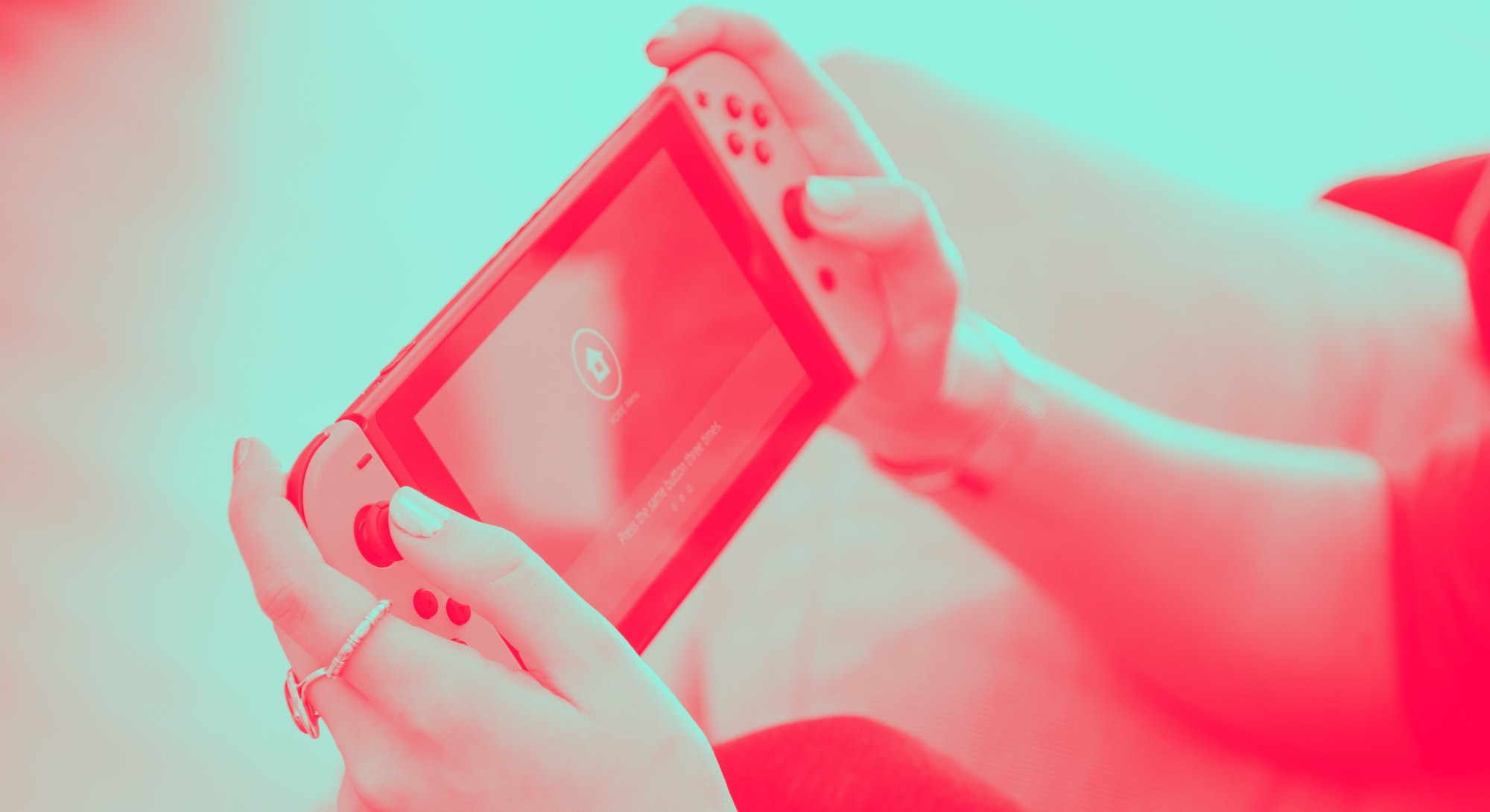 Detail of a young woman playing video games on a Nintendo Switch home console, taken on March 7, 201...