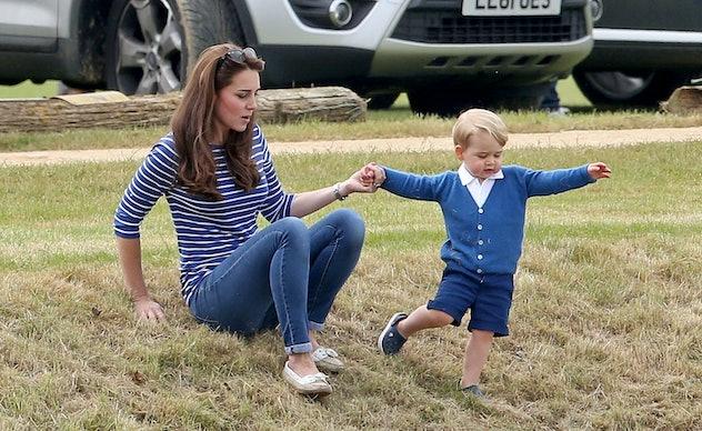 Prince George helps his mom.