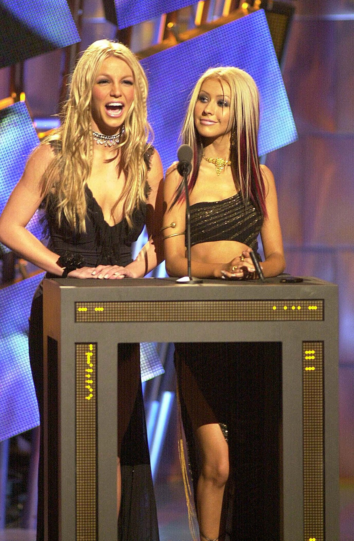 Britney Spears and Christina Aguilera during MTV VMA 2000 Stage at Radio City Music Hall in New York...