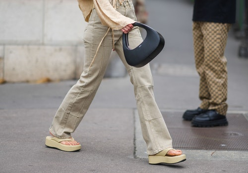 PARIS, FRANCE - JUNE 23: Alice Barbier wears a ripped pullover with flared sleeves, pale khaki patch...