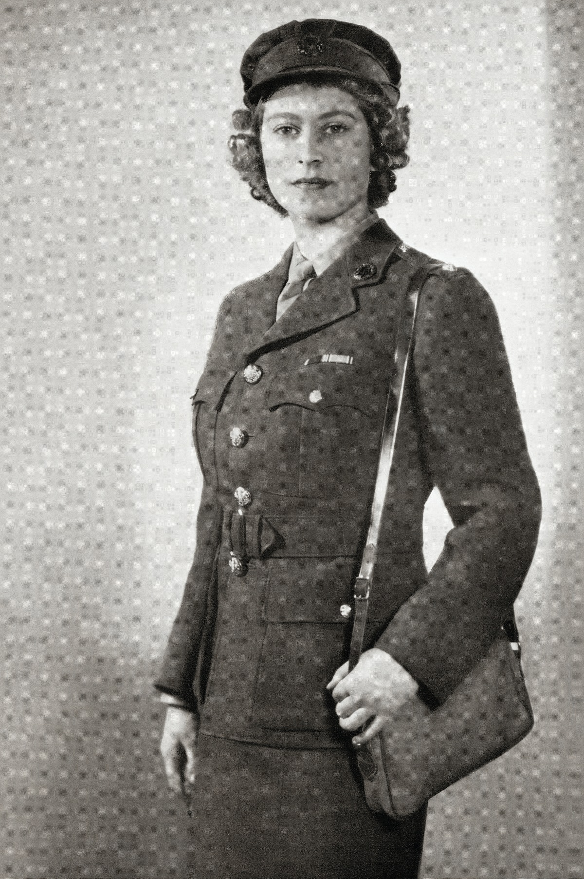 Queen Elizabeth is seen here in 1945 in the uniform of second subaltern in the A.T.S. From a photog...