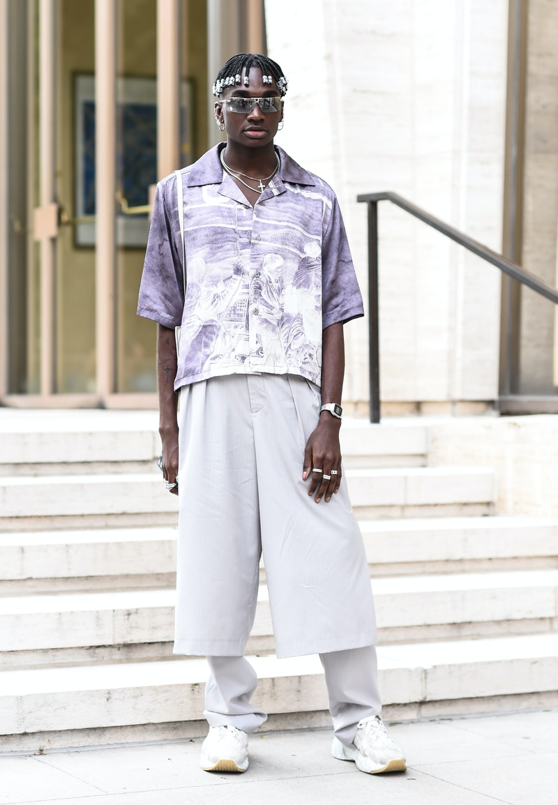 NEW YORK, NEW YORK - SEPTEMBER 07: Rickey Thompson is seen wearing a purple and white graphic top, cream pants and white sneakers outside the Longchamp show during New York Fashion Week S/S20 on September 07, 2019 in New York City. (Photo by Daniel Zuchnik/Getty Images)