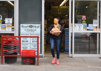 NEW YORK, NEW YORK - JUNE 25: A person wears a protective face mask outside a supermarket in Brooklyn as New York City moves into Phase 2 of re-opening following restrictions imposed to curb the coronavirus pandemic on June 25, 2020. Phase 2 permits the reopening of offices, in-store retail, outdoor dining, barbers and beauty parlors and numerous other businesses. Phase 2 is the second of four-phased stages designated by the state. (Photo by Noam Galai/Getty Images)