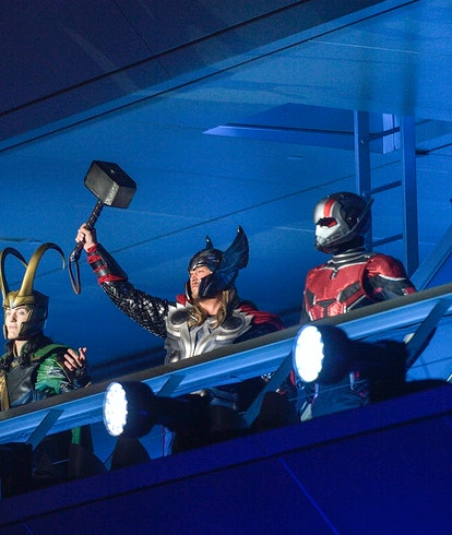 Loki, Thor, and Iron Man stand at Avenger Headquarters during the opening ceremony for Avengers Camp...