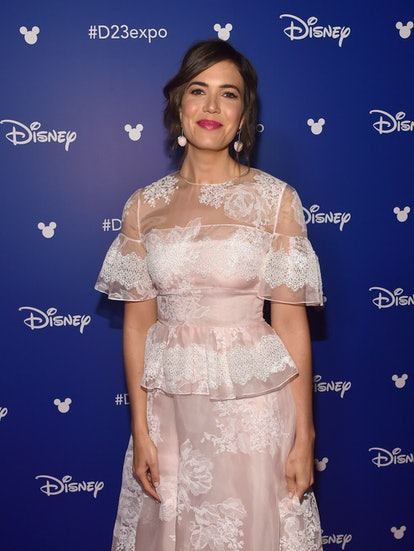 Mandy Moore's go-to red carpet look is some variation of loose waves paired with a statement lip.
