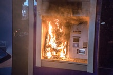 BARCELONA, CATALONIA, SPAIN - 2021/02/20: An ATM seen on fire during the demonstration. Protesters d...