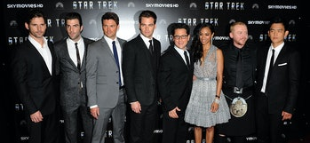 (Left to right) Eric Bana, Zachary Quinto, Karl Urban, Chris Pine, JJ Abrams, Zoe Saldana, Simon Pegg and John Cho pose for photographs as they arrive for the UK Film Premiere of Star Trek at the Empire Leicester Square, London.   (Photo by Ian West - PA Images/PA Images via Getty Images)