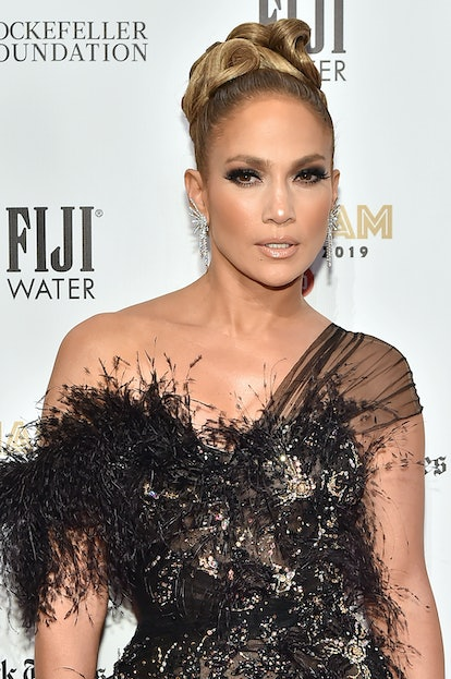 Jennifer Lopez shows off her Leo energy while walking the red carpet.