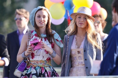Leighton Meester and Blake Lively on the set of 'Gossip Girl' on July 5, 2010 in Paris, France.